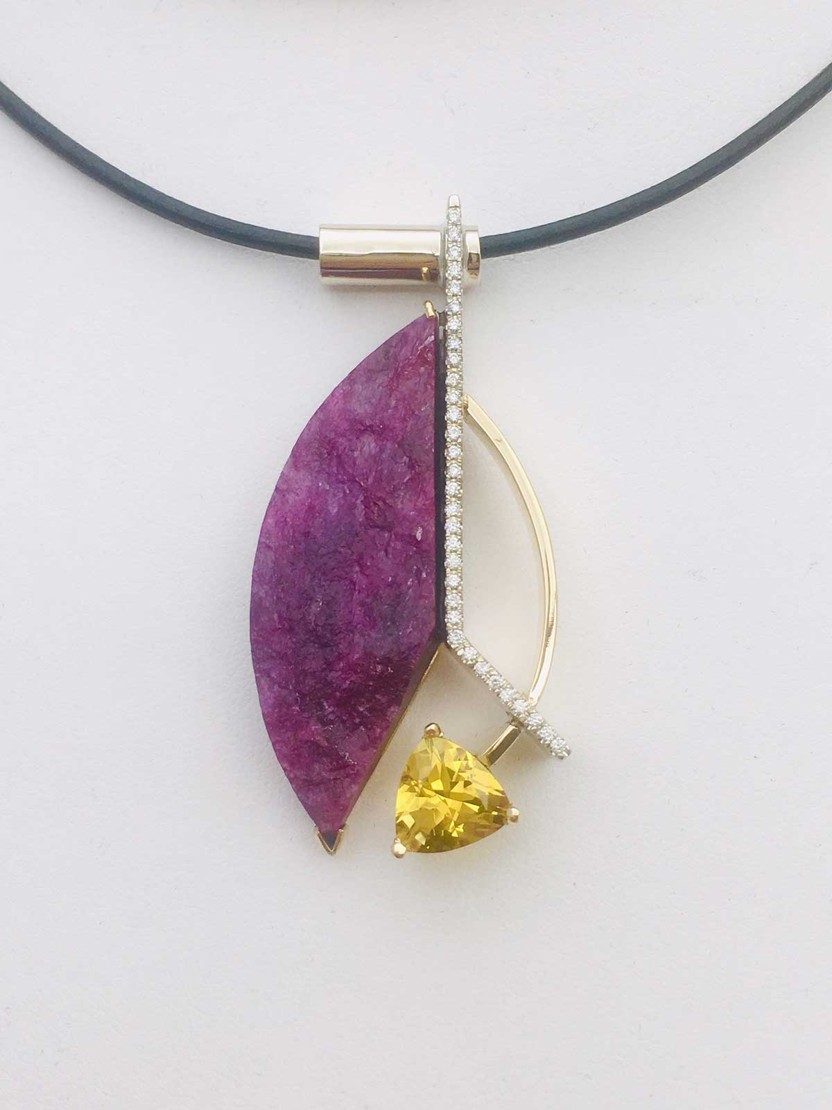 Custom designed pendant with an African, natural Ruby crystal accented with Pave Diamonds and a trillion-cut Golden Heliodor. Crafted in 14k yellow and white gold