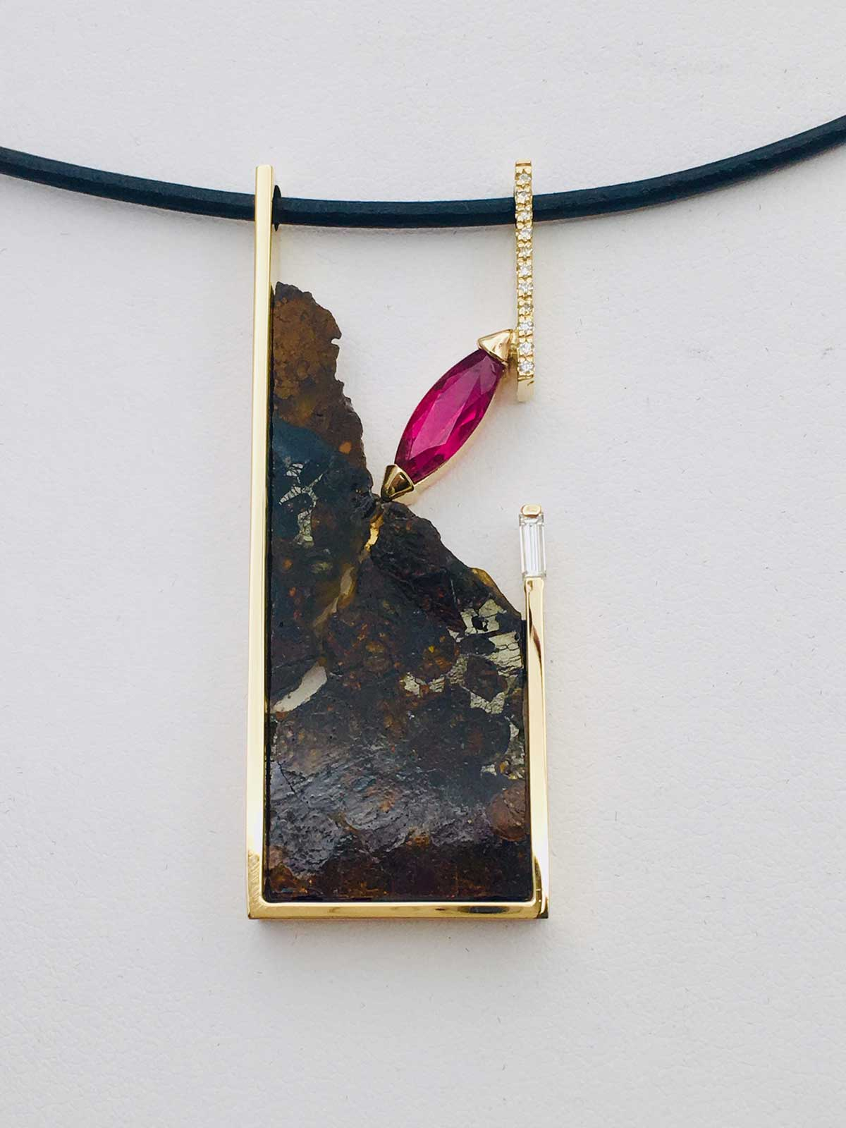 Unique pendant in 14k yellow gold framing a polished slice of Pallasitic Meteorite and accented with a Marquise Rubellite and Diamonds
