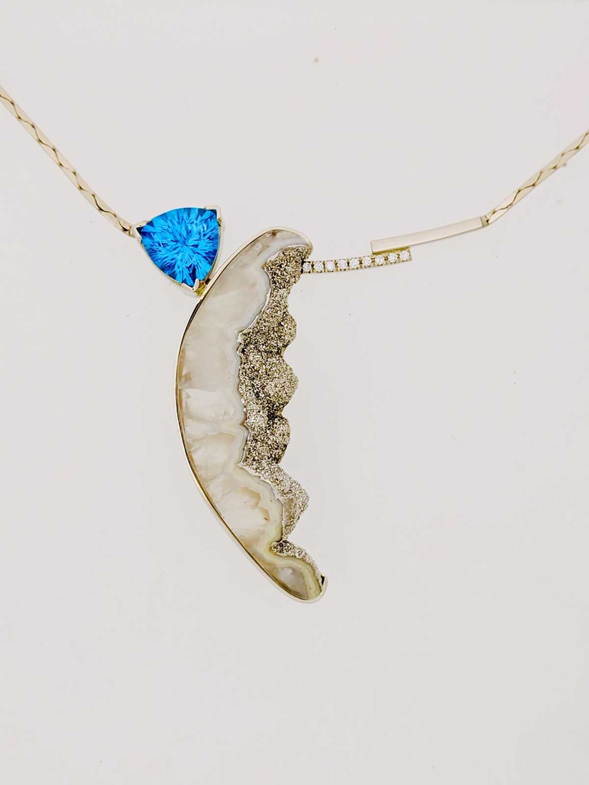 14k yellow gold necklace displaying a Platinum-coated, Druzy Agate with a Precision-cut, Blue Topaz trillion and accented with pave Diamonds