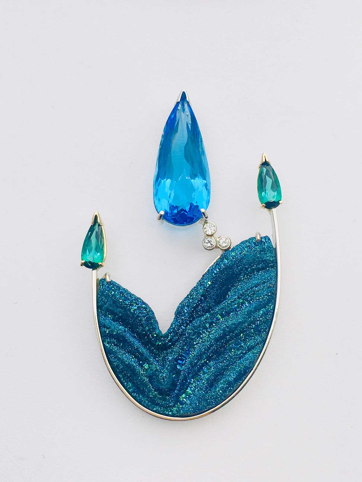 One-of-a-kind pendant set with a Titanium vapor coated, Blue Druzy and fabricated in 14k yellow gold. Also set with a large pear shape Blue Topaz, matched Green Tourmalines and Diamond accents