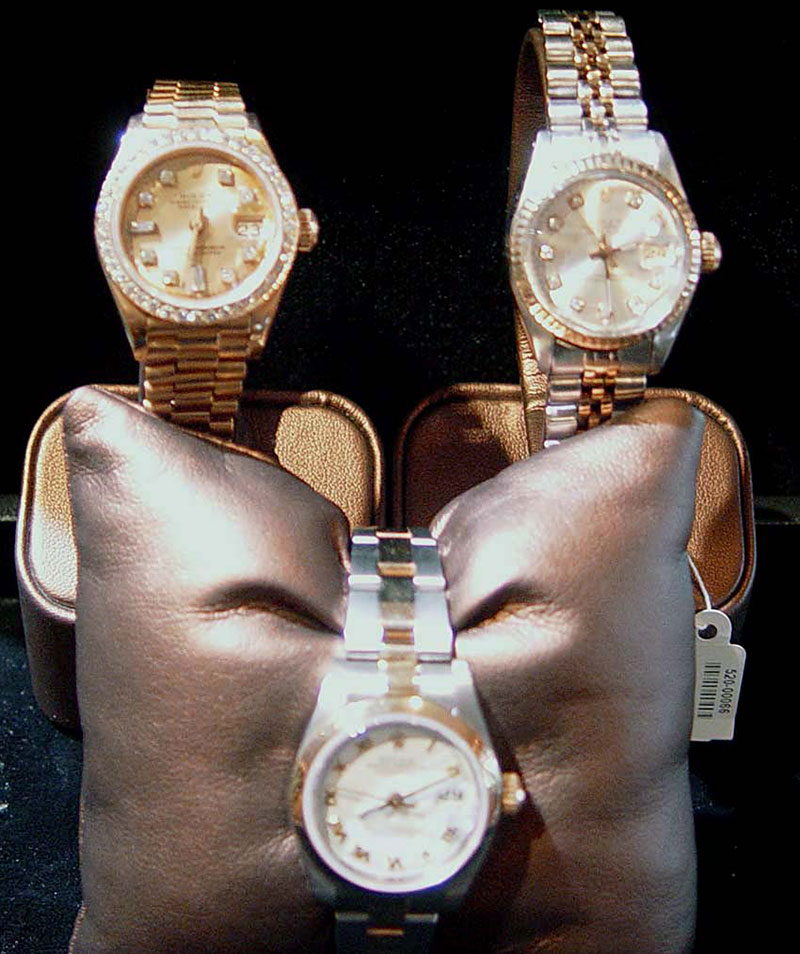 Three high end watches on display