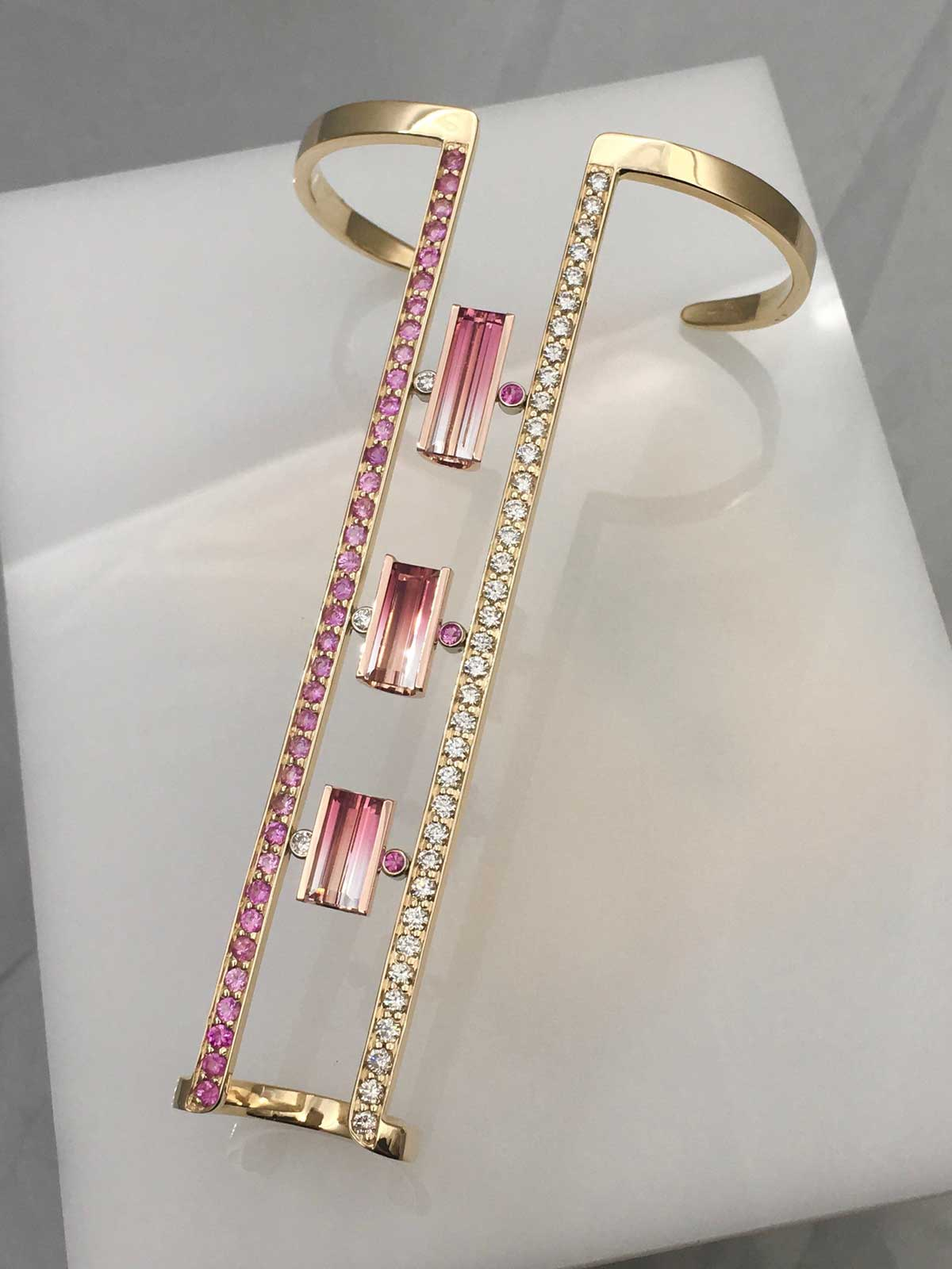 "Our trademarked ""Racelet"" ( ring and bracelet combination) displaying a bicolor, Pink/clear Tourmailne suite accented with Lab Diamonds and Pink Sapphires in 14k, handforged gold"