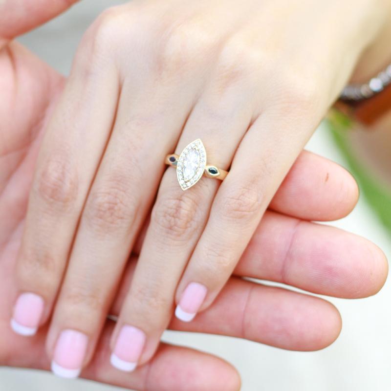 Woman hand wearing diamond ring holding male hand