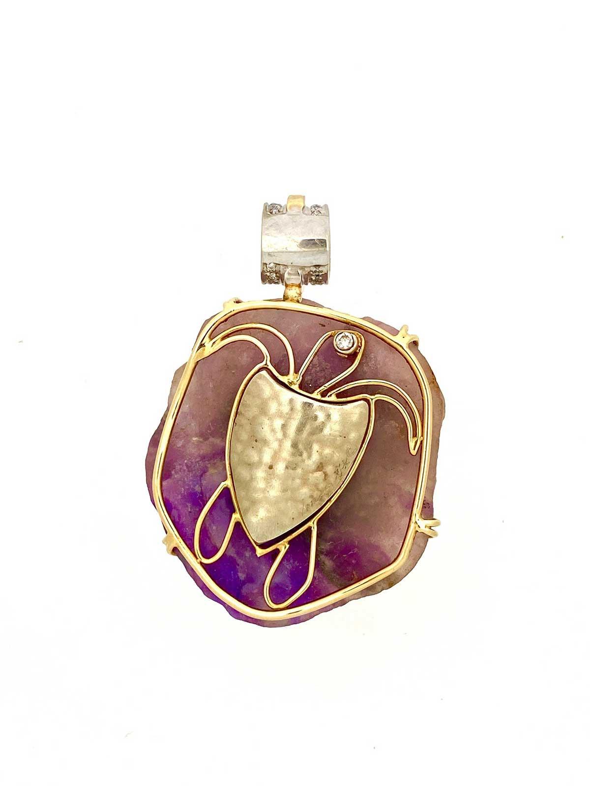 Back of custom carved turtle pendant