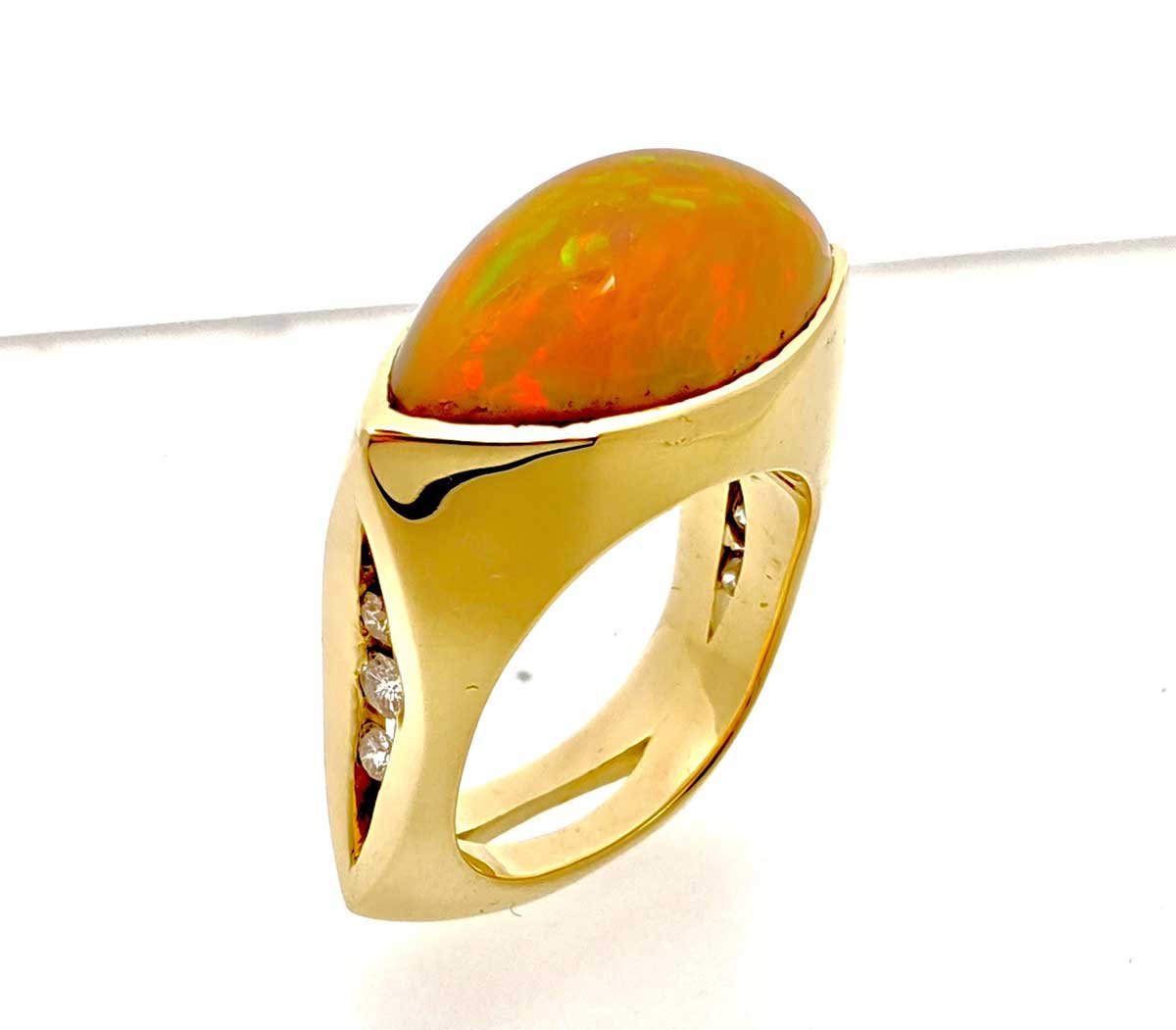 Fire opal, yellow gold and diamond ring