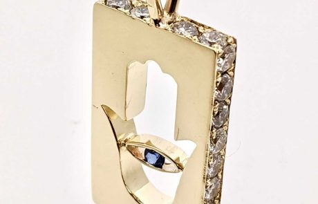 Gold Hand of God pendant with client supplied diamonds and tension set sapphire