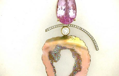 Pear kunzite pendant with pave and bezel set diamonds, geode and yellow and white gold