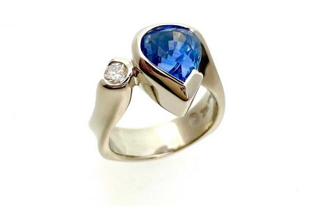 Yellow gold, pear shaped sapphire, diamond ring custom designed for customer