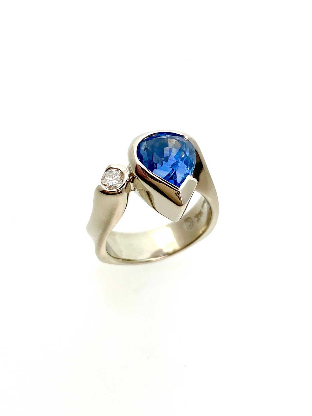 Yellow gold, pear shaped sapphire, diamond ring custom designed for customer