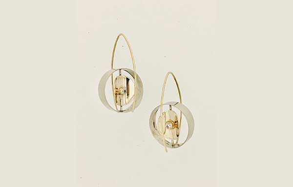 Sculptural yellow and white gold reverse wire earrings with bezel set diamonds