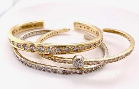 Custom-fitted diamond cuff bracelets forged in yellow gold