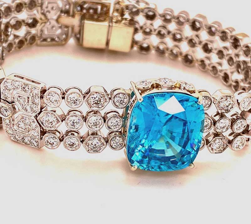Outrageous 22ct cushion-cut Blue Zircon on a deco-esque diamond bracelet