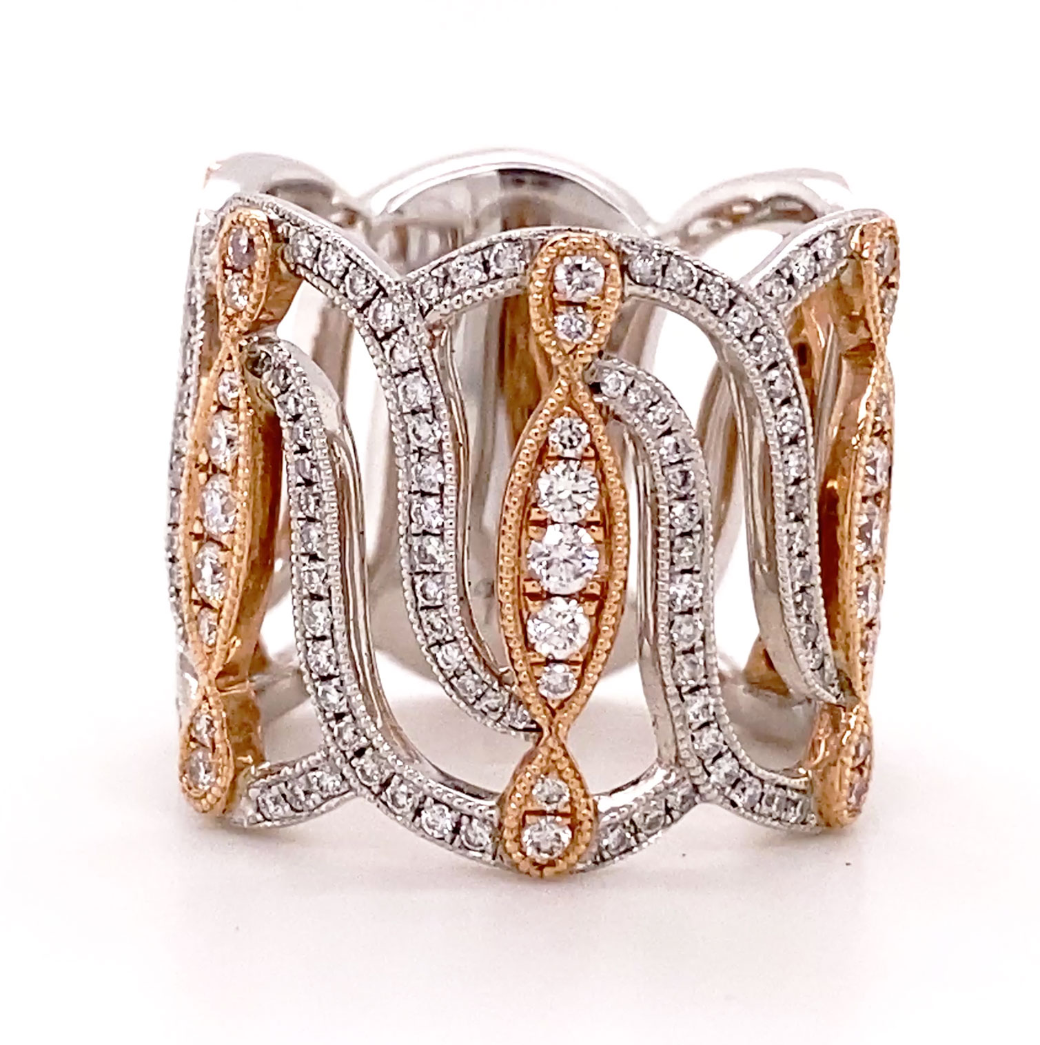 A lacey and feminine wide Diamond band balancing rose and white gold