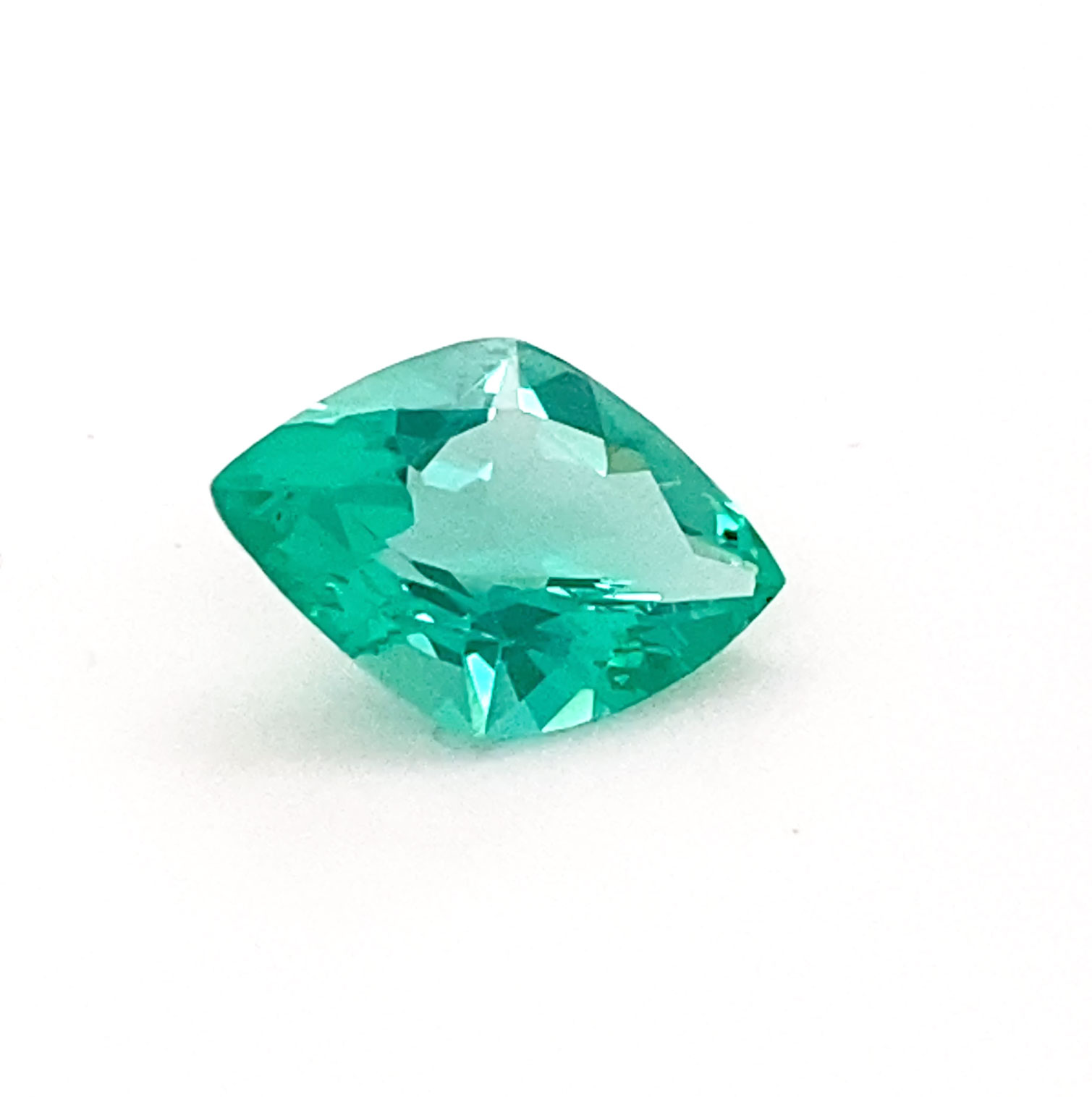 A rare kite-shaped Emerald of exceptional clarity and crisp green