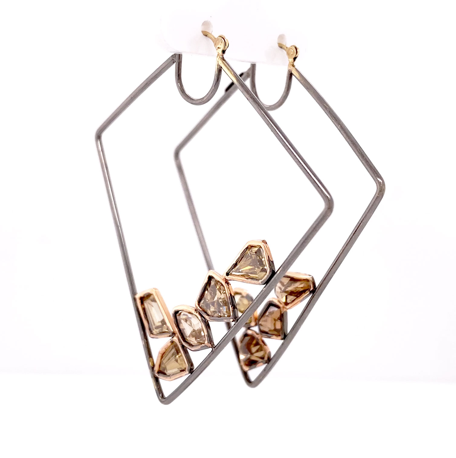 A spectacular pair of 14k blackened gold earrings set with rose gold framed cognac, fancy-shaped Diamonds each a unique cut with over 7cts total weight