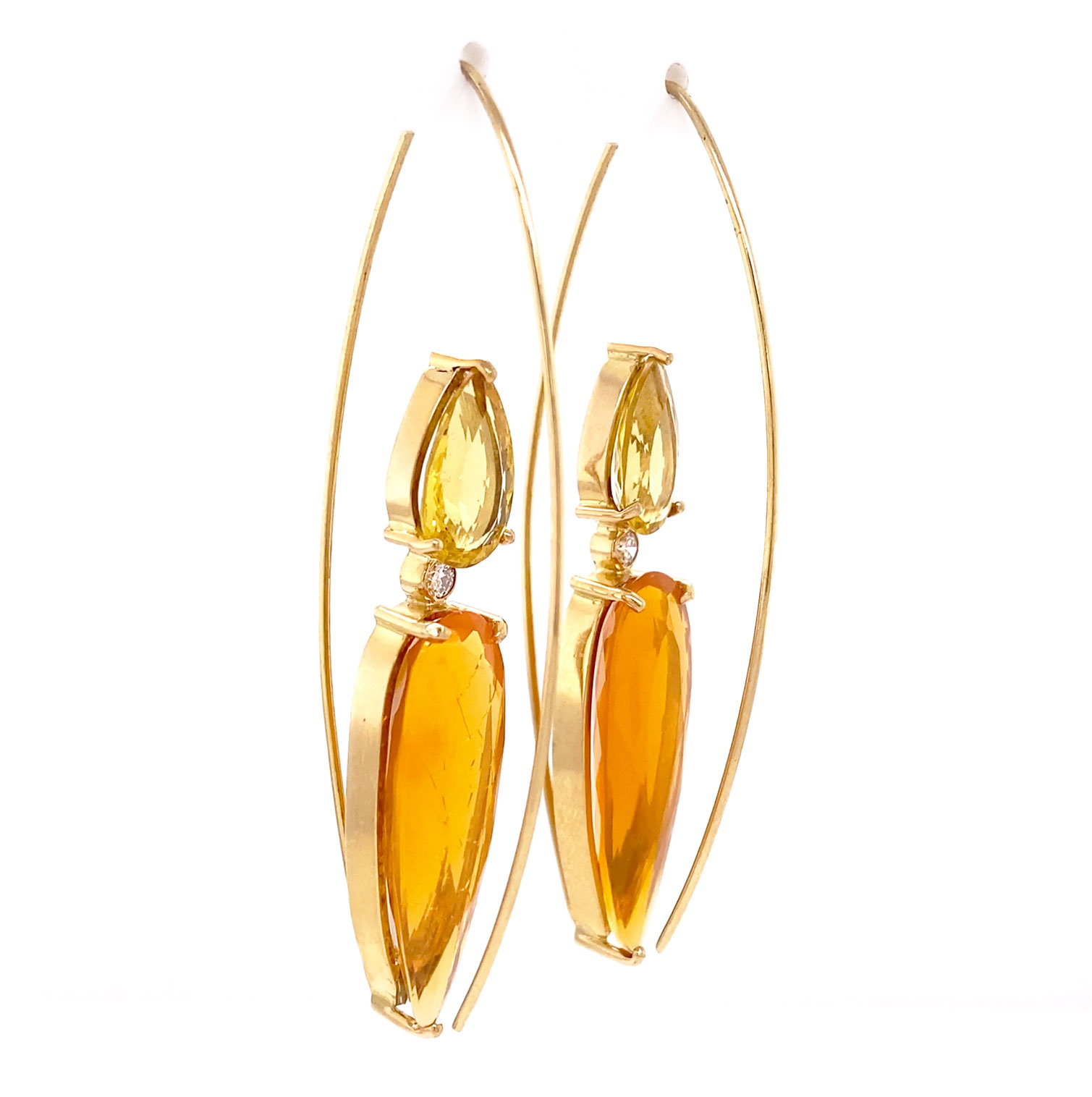 An amazing pair of 14k yellow gold, reverse-wire earrings set with Brazilian Orange Fire Opals on the bottom and paired with Golden Emerald (Beryl) pearshapes on the top. Accented with Diamonds in between the stunning gems. One-of-a-kind from Mark Loren!