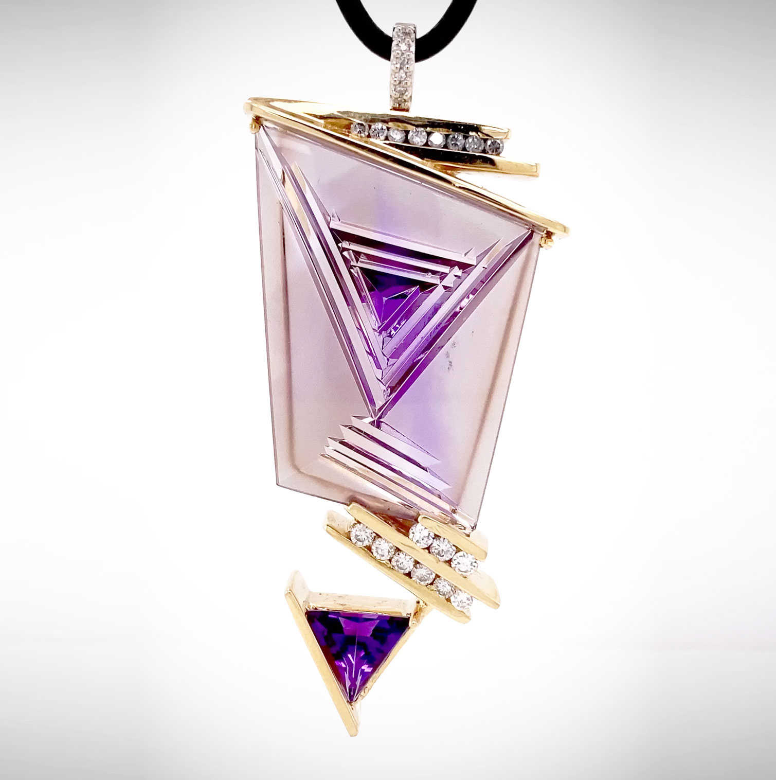 One-of-a-Kind pendant showcasing an amazing Bernd Munsteiner-cut Ametrine accented with Diamond and trillion Amethyst and crafted in 14K yellow gold