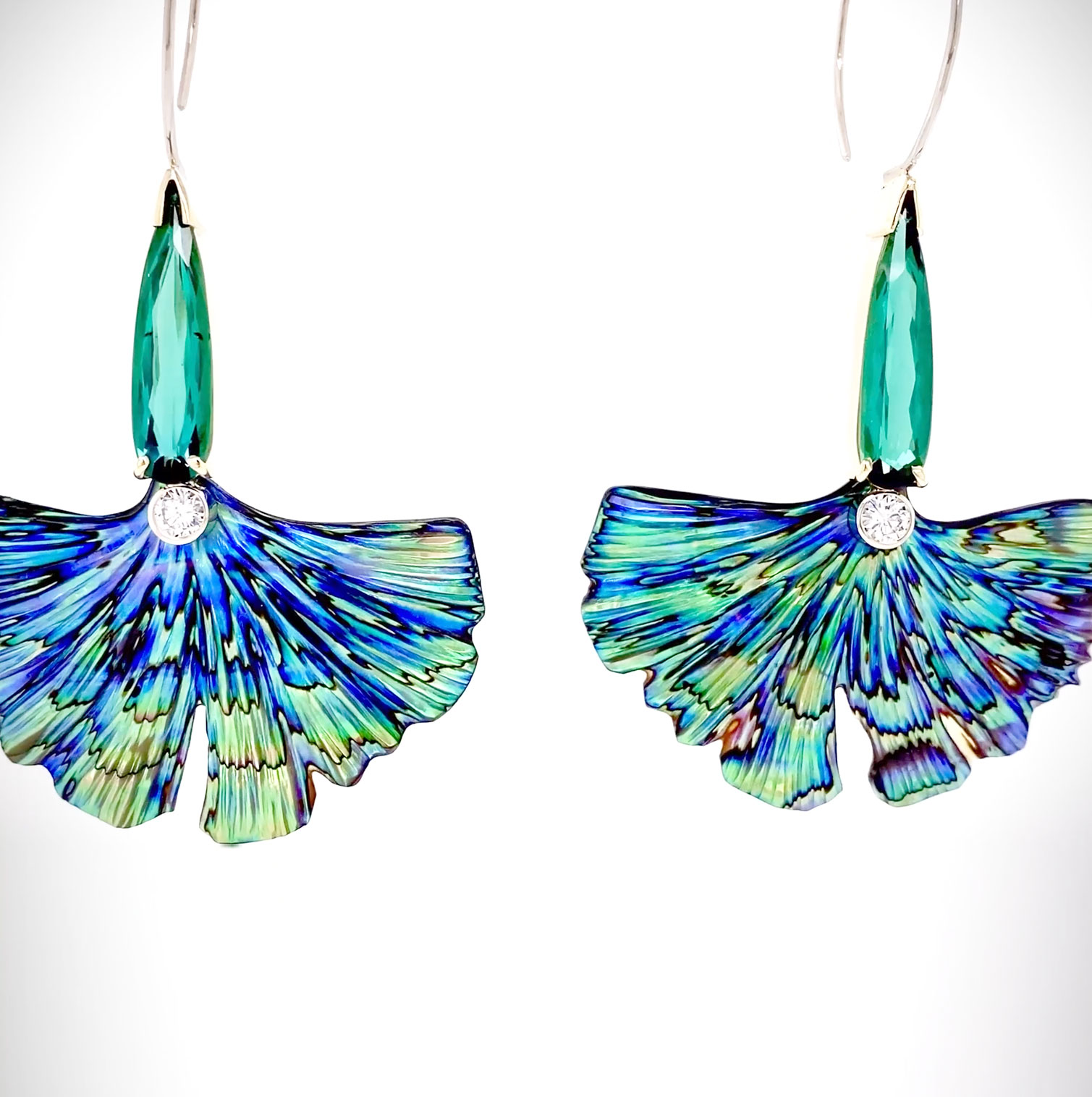 One-of-a-kind earrings with colorful, hand-carved Abalone Ginko leaves leading up to long pear-shaped Green Tourmalines accented with Diamonds