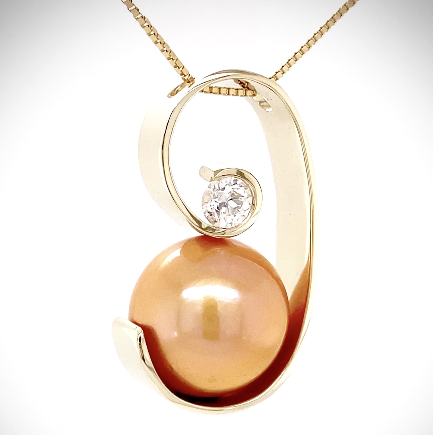 One-of-a-kind hand-forged with one piece of 14K yellow gold, we cradled this rare 15mm Golden South Sea Pearl and accented it with a .30ct round brilliant Diamond