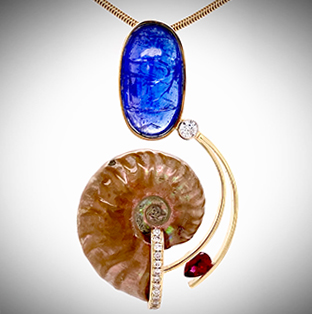 One-of-a-kind pendant forged in 14K yellow gold balancing a gorgeous fossilized Ammonite with a Cabochon-cut Tanzanite and accented with pave Diamonds, bezel set Diamond and a bright raspberry pear-shape Sapphire