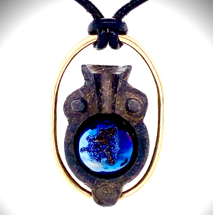 Suspended from a Spanish leather cord, this masculine pendant frames a Medieval bronze bullet 1/2 mold showcasing a Blue Druzy Agate sphere and framed in 14K yellow gold