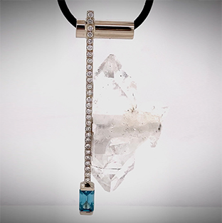 Hand-forged in 14K white gold and delicately displaying a perfectly clear, twin-terminating Quartz Crystal and accented with pave lab-grown Diamonds and an Emerald-cut Cambodian Blue Zircon