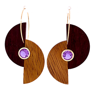 "Extremely one-of-a-kind, this bold pair of 14k yellow gold earrings utilizes purple heartwood and bezel set ""Twilight"" colorshift gemstones"