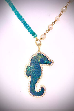 A stunning necklace strung with ultra-rare grandidierite faceted beads and Akoya pearls suspends a removable diamond-framed pendant of an ancient Roman bronze seahorse circa 400 AD.