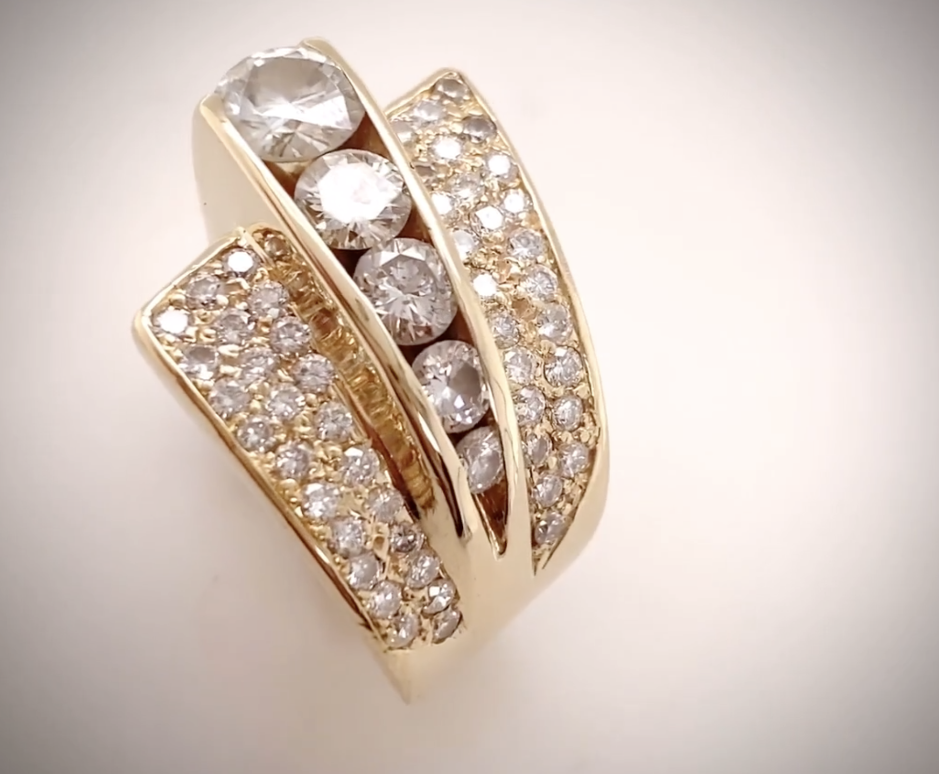Our client's diamonds were set in 14K yellow gold in a custom-designed dramatic wedge.