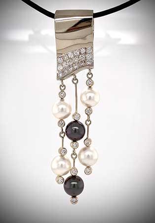 Custom-designed 14K white gold pendant displays Tahitian black pearls and diamonds.