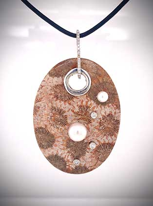 One-of-a-kind pendant in fossilized Indonesian coral is accented with an Akoya pearl and diamonds