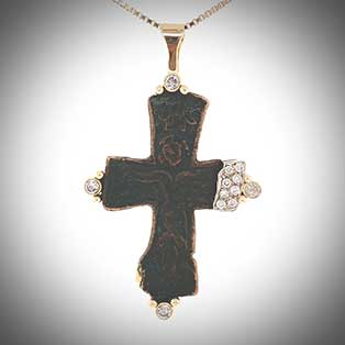 One-of-a-kind pendant with a 13th century bronze cross fragment is finished in pavé-set diamonds and 14K gold.