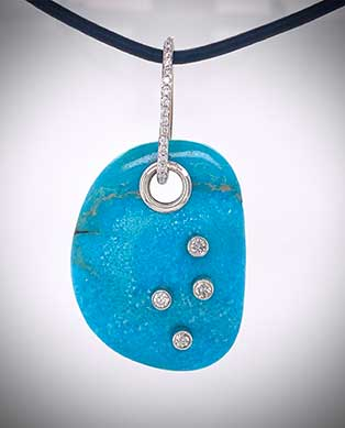 Unique pendant with morenci turquoise is accented with an Akoya pearl and diamonds.
