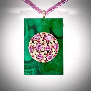 This one-of-a-kind pendant crafted in 18K yellow gold is set with pink sapphires, rubies and diamonds framed on a solid block of fine malachite and clipped to a necklace of faceted pink sapphire beads.