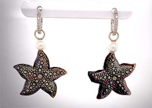 One-of-a-kind ear pendants are made with hand-carved, black mother-of-pearl starfish accented with Akoya pearls.