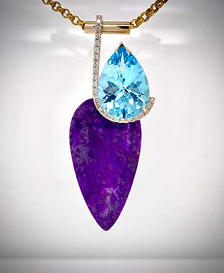 One-of-a-kind pendant pairsa rare South Africansugalitewith apear shape bluetopaz andpavédiamond accent in 14K gold