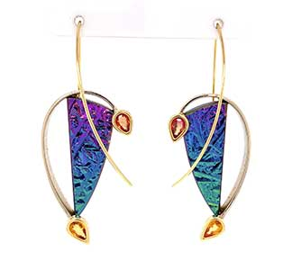 Astunning pair of 14Kyellow gold earringsare hand-forged with tension-setrainbowsilicon slices accented withpear-shapedorangesapphires.
