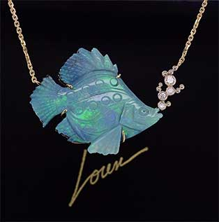 """A one-of-a-kind carved Australianopal fish necklaceisaccented withdiamond""""bubbles""""in 14K yellow gold."""